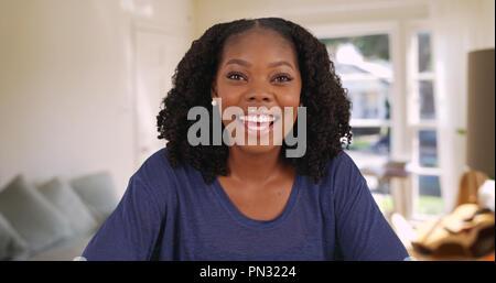 pov shot of cute happy black woman having video chat inside living room pn3224