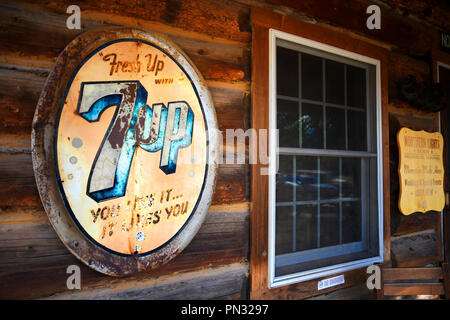 POLEBRIDGE, MONTANA, USA -  September 9, 2018: Vintage 7Up soda sign hangs on the exterior of Northern Lights Salooon - Stock Photo