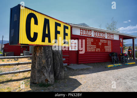 LIMA, MONTANA, USA - August 11, 2018: Exterior of a log cabin cafe featuring home cooked grub - Stock Photo