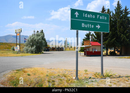 LIMA, MONTANA, USA - August 11, 2018: Road sign off of Interstate 15 with directions to Idaho Falls, Idaho, and Butte, Montana - Stock Photo
