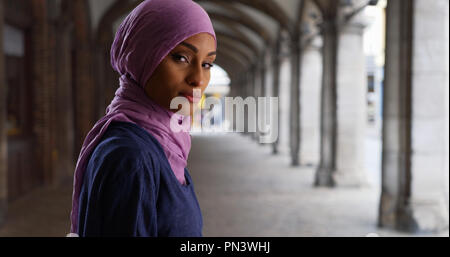 Young beautiful Muslim woman in headscarf posing for a portrait - Stock Photo