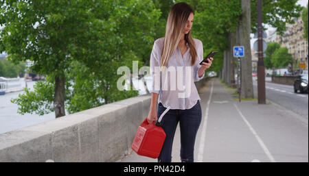 Find Nearest Gas Station >> Woman With Plastic Jerrycan Using Phone To Find Nearest Gas