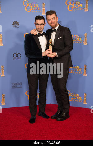 "After winning the category of BEST ORIGINAL SONG – MOTION PICTURE for 'Writing's on the Wall' for ""Spectre"" - music and lyrics by: Jimmy Napes and Sam Smith - pose with the award backstage in the press room at the 73rd Annual Golden Globe Awards at the Beverly Hilton in Beverly Hills, CA on Sunday, January 10, 2016. - Stock Photo"