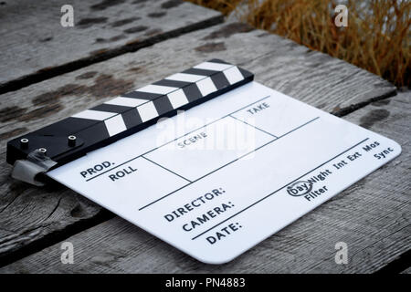 Directors clapboard on a wooden walkway on a movie set - Stock Photo