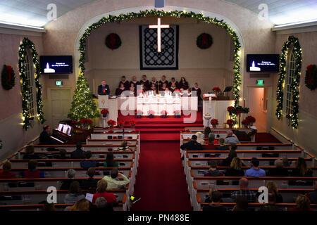 KALISPELL, MONTANA, USA - December 24, 2017: Pastor Steve Hermes preaches at a nighttime Christmas Eve service at Epworth Methodist Church. - Stock Photo