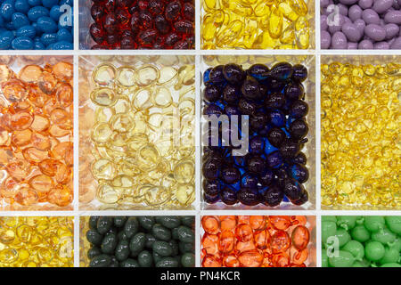 hair and skin vitamin serum in soft capsules, background and texture - Stock Photo