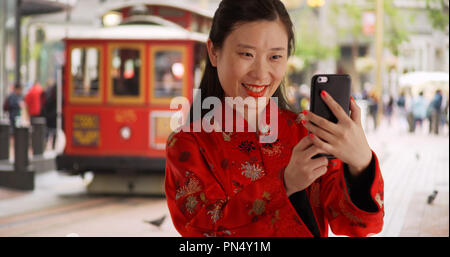 Close up of millennial Chinese taking selfie in San Francisco - Stock Photo
