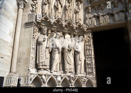Statue of decapitated Saint Denis at the Notre-Dame Cathedral in Paris France. - Stock Photo