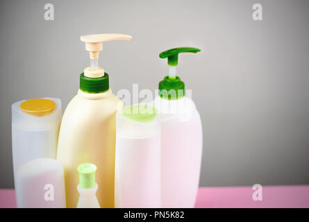 Cosmetics for hair and body care white bottles on a gray background Natural organic product. Copy space selective focus - Stock Photo