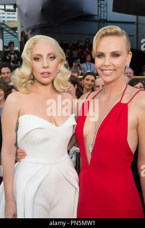 Oscar®-nominee Lady Gaga and Charlize Theron arrive at The 88th Oscars® at the Dolby® Theatre in Hollywood, CA on Sunday, February 28, 2016.  File Reference # 32854_350THA  For Editorial Use Only -  All Rights Reserved - Stock Photo