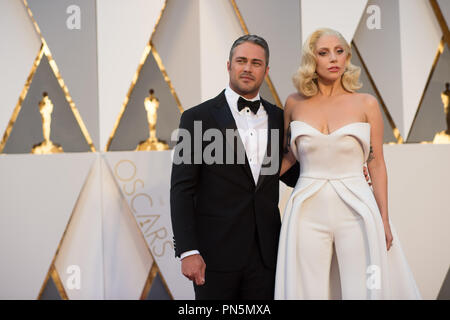 Oscar®-nominee, Lady Gaga, arrives with Taylor Kinney at The 88th Oscars® at the Dolby® Theatre in Hollywood, CA on Sunday, February 28, 2016.  File Reference # 32854_385THA  For Editorial Use Only -  All Rights Reserved - Stock Photo