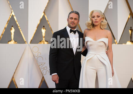 Oscar®-nominee, Lady Gaga, arrives with Taylor Kinney at The 88th Oscars® at the Dolby® Theatre in Hollywood, CA on Sunday, February 28, 2016.  File Reference # 32854_386THA  For Editorial Use Only -  All Rights Reserved - Stock Photo