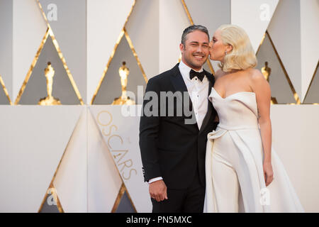 Oscar®-nominee, Lady Gaga, arrives with Taylor Kinney at The 88th Oscars® at the Dolby® Theatre in Hollywood, CA on Sunday, February 28, 2016.  File Reference # 32854_387THA  For Editorial Use Only -  All Rights Reserved - Stock Photo
