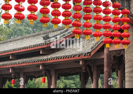 Group of red chinese lanterns with chinese traditional architecture in the background, Chengdu, China - Stock Photo