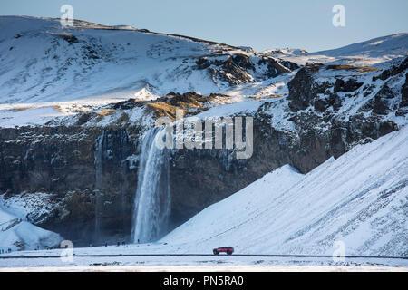 Spectacular waterfall Seljalandsfoss in South Iceland with glacial melting waters from Eyjafjahajokul icecap - Stock Photo