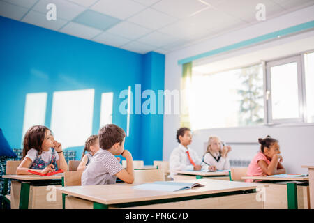 school children participating actively in class. Education, learning, high school - Stock Photo