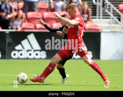 Washington, DC, USA. 16th Sep, 2018. 20180916 - New York Red Bulls defender TIM PARKER (26) defends an advance by D.C. United midfielder LUCIANO ACOSTA (10) in the first half at Audi Field in Washington. Credit: Chuck Myers/ZUMA Wire/Alamy Live News - Stock Photo