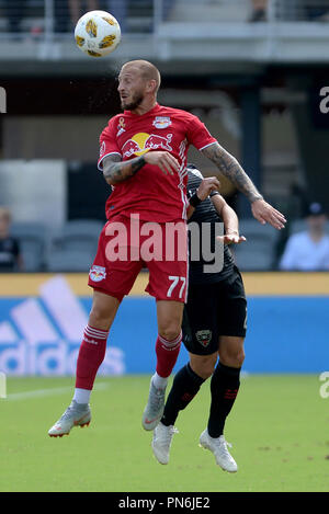 Washington, DC, USA. 16th Sep, 2018. 20180916 - New York Red Bulls midfielder DANIEL ROYER (77) heads the ball against D.C. United defender JOSEPH MORA (28) in the first half at Audi Field in Washington. Credit: Chuck Myers/ZUMA Wire/Alamy Live News - Stock Photo