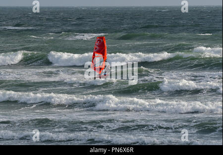 East Wittering, UK. 19th September 2018. Windsurfer(s )brave wild, wet and windy weather  of Storm Ail - our first named storm of the season. Weather was  recorded at the Chichester Bar at 3pm BST  a mean speed of 29 Knots highest gusting  35 .4 Knots The Met Office have issued an yellow weather warning for this area with strong winds and heavy rainfall.Credit Gary Blake / Alamy Live News - Stock Photo