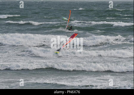 East Wittering, UK. 19th September 2018. Windsurfers brave wild, wet and windy weather  of Storm Ail - our first named storm of the season. Weather was  recorded at the Chichester Bar at 3pm BST  a mean speed of 29 Knots highest gusting  35 .4 Knots The Met Office have issued an yellow weather warning for this area with strong winds and heavy rainfall.Credit Gary Blake / Alamy Live News - Stock Photo