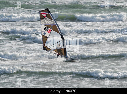 East Wittering, UK. 19th September 2018. Windsurfer(s) brave wild, wet and windy weather  of Storm Ail - our first named storm of the season. Weather was  recorded at the Chichester Bar at 3pm BST  a mean speed of 29 Knots highest gusting  35 .4 Knots The Met Office have issued an yellow weather warning for this area with strong winds and heavy rainfall.Credit Gary Blake / Alamy Live News - Stock Photo