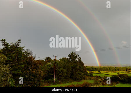 Ballydehob, West Cork, Ireland. 20th Sept, 2018.  After a day of incessant rain, a double rainbow appears over Ballydehob.  Rain will return this evening and into tomorrow. Credit: Andy Gibson/Alamy Live News. - Stock Photo