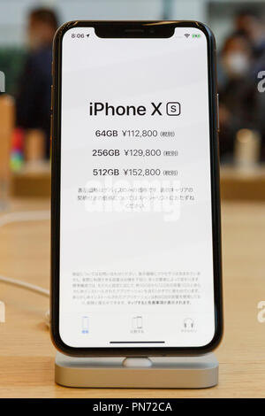 A sample of the new iPhone XS on display at the Apple Store in Omotesando on September 21, 2018, Tokyo, Japan. Apple fans lined up patiently in the early morning rain to get the new iPhone models (XS and XS Max) and the new iWatch (Series 4). The new iPhone XS costs JPY 112,800 for the 64 GB model, the iPhone XS Max costs JPY 124,800 JPY for the 64 GB model, and iWatch Series 4 costs JPY 45,800. Credit: Rodrigo Reyes Marin/AFLO/Alamy Live News - Stock Photo