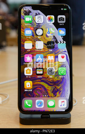 A sample of the new iPhone XS Max on display at the Apple Store in Omotesando on September 21, 2018, Tokyo, Japan. Apple fans lined up patiently in the early morning rain to get the new iPhone models (XS and XS Max) and the new iWatch (Series 4). The new iPhone XS costs JPY 112,800 for the 64 GB model, the iPhone XS Max costs JPY 124,800 JPY for the 64 GB model, and iWatch Series 4 costs JPY 45,800. Credit: Rodrigo Reyes Marin/AFLO/Alamy Live News - Stock Photo
