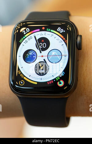 A sample of the new iWatch (Series 4) on display at the Apple Store in Omotesando on September 21, 2018, Tokyo, Japan. Apple fans lined up patiently in the early morning rain to get the new iPhone models (XS and XS Max) and the new iWatch (Series 4). The new iPhone XS costs JPY 112,800 for the 64 GB model, the iPhone XS Max costs JPY 124,800 JPY for the 64 GB model, and iWatch Series 4 costs JPY 45,800. Credit: Rodrigo Reyes Marin/AFLO/Alamy Live News - Stock Photo