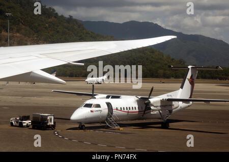 Link PNG aircraft (Air Niugini) ready on tarmac at Cairns International Airport, Cairns, Queensland, Australia. No PR - Stock Photo