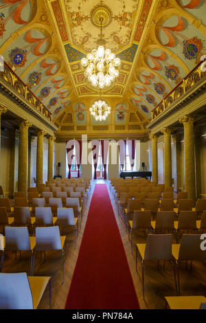 Kosice, Slovakia - August 12, 2018: Assembly hall, the so-called historic hall, with illusive arcades showing the coat of arms of former Abauj-Torna C - Stock Photo