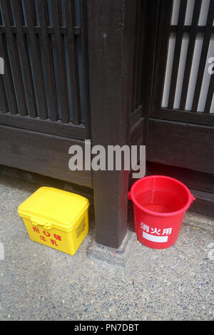 Emergency supplies including bucket of water in traditional wooden district of Kyoto, Japan. No PR