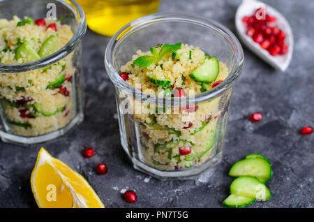 Couscous Salad in a Jar with Pomegranate, Mint and Cucumbers, Healthy Homemade Food, Vegan Meal - Stock Photo