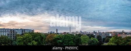 Berlin-Mitte. Skyline panoramic view of apartment buildings, TV tower, churches. Panorama at sunrise - Stock Photo