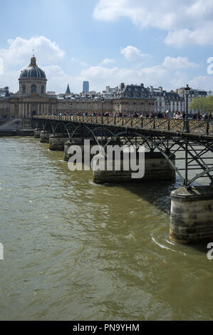 Paris, France, French academy with the bridge of arts full of love locks. - Stock Photo