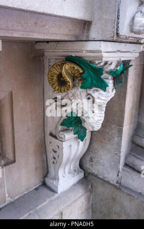 Architectural detail: stucco work ram's head with gilded horns on a building in St Swithin's Lane and Cannon Street in the City of London EC4 - Stock Photo