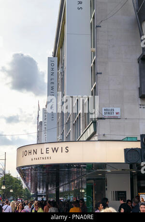 Entrance sign and canopy outside the flagship John Lewis & Partners department store in Oxford Street in the West End shopping area of central London - Stock Photo