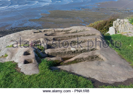 Unusual Stone Graves cut into the rock near to St Patrick's Chapel overlooking the sea at Heysham, Lancashire - Stock Photo