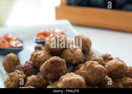 Cocktail beef meatballs in sweet and tomato sauce. Also available in horizontal. - Stock Photo