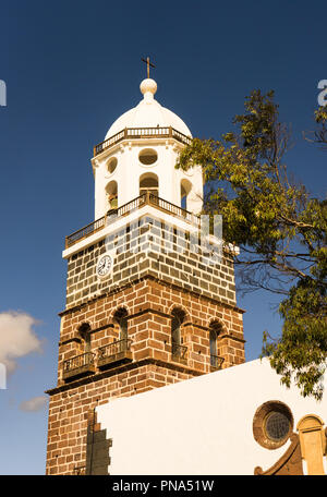 TEGUISE, SPAIN  DECEMBER 13, 2017: Bell tower of Iglesia de Nuestra Senora de Guadalupe church on December 13, 2017, in Teguise, Spain. - Stock Photo