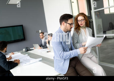 Group of architects and business people working together - Stock Photo