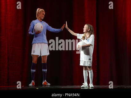 Manchester City and England Women's football captain, Steph Houghton (left), takes part in the UK's first 5G holographic call as part of Vodafone's 5G trials staged between Manchester and Newbury where she conducted a virtual training session with young fan Iris, 11, from Surrey. - Stock Photo