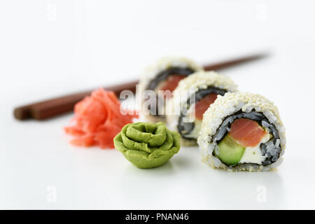 Sushi roll with ginger and wasabi closeup - Stock Photo