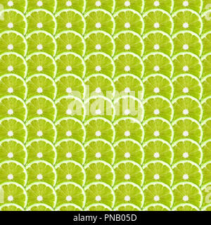 Green lime slices pattern background. Natural symmetrical full frame food texture - Stock Photo