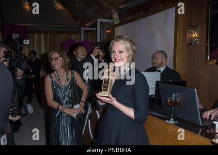 After winning the category of BEST PERFORMANCE BY AN ACTRESS IN A TELEVISION SERIES – DRAMA for her role in 'The Handmaid's Tale,' actress Elisabeth Moss poses backstage with her Golden Globe Award at the 75th Annual Golden Globe Awards at the Beverly Hilton in Beverly Hills, CA on Sunday, January 7, 2018. - Stock Photo
