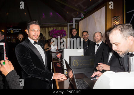 After winning the category of BEST PERFORMANCE BY AN ACTOR IN A MOTION PICTURE – COMEDY OR MUSICAL for his work in 'The Disaster Artist,' actor James Franco poses backstage at the 75th Annual Golden Globe Awards at the Beverly Hilton in Beverly Hills, CA on Sunday, January 7, 2018. - Stock Photo