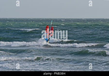 Windsurfers in rough seas on East Wittering Beach, Nr. Chichester, West Sussex, United Kingdom, England - Stock Photo