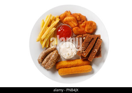 Hot appetizer croutons from rye bread, set of chicken nuggets, sausages, cheese sticks in breading, French fries, mayonnaise sauce, tar-tar, ketchup o - Stock Photo