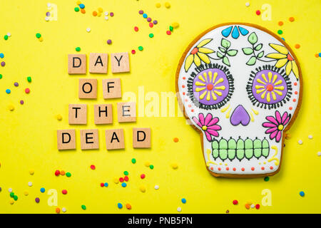 Dia de los muertos concept - skull shaped cookies with colorful decorations - Stock Photo