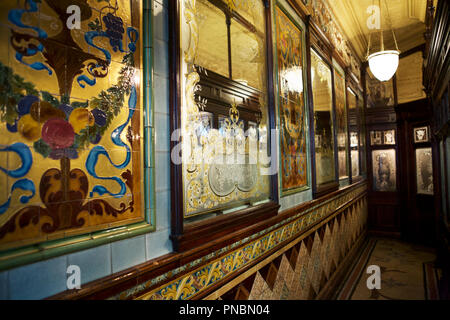 Etched glass and Victorian tiles, in the Princess Louise pub, Holborn, London, UK. - Stock Photo